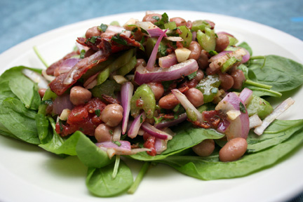 Grilled Sausages With Caramelized Onions And Apples And Three Bean